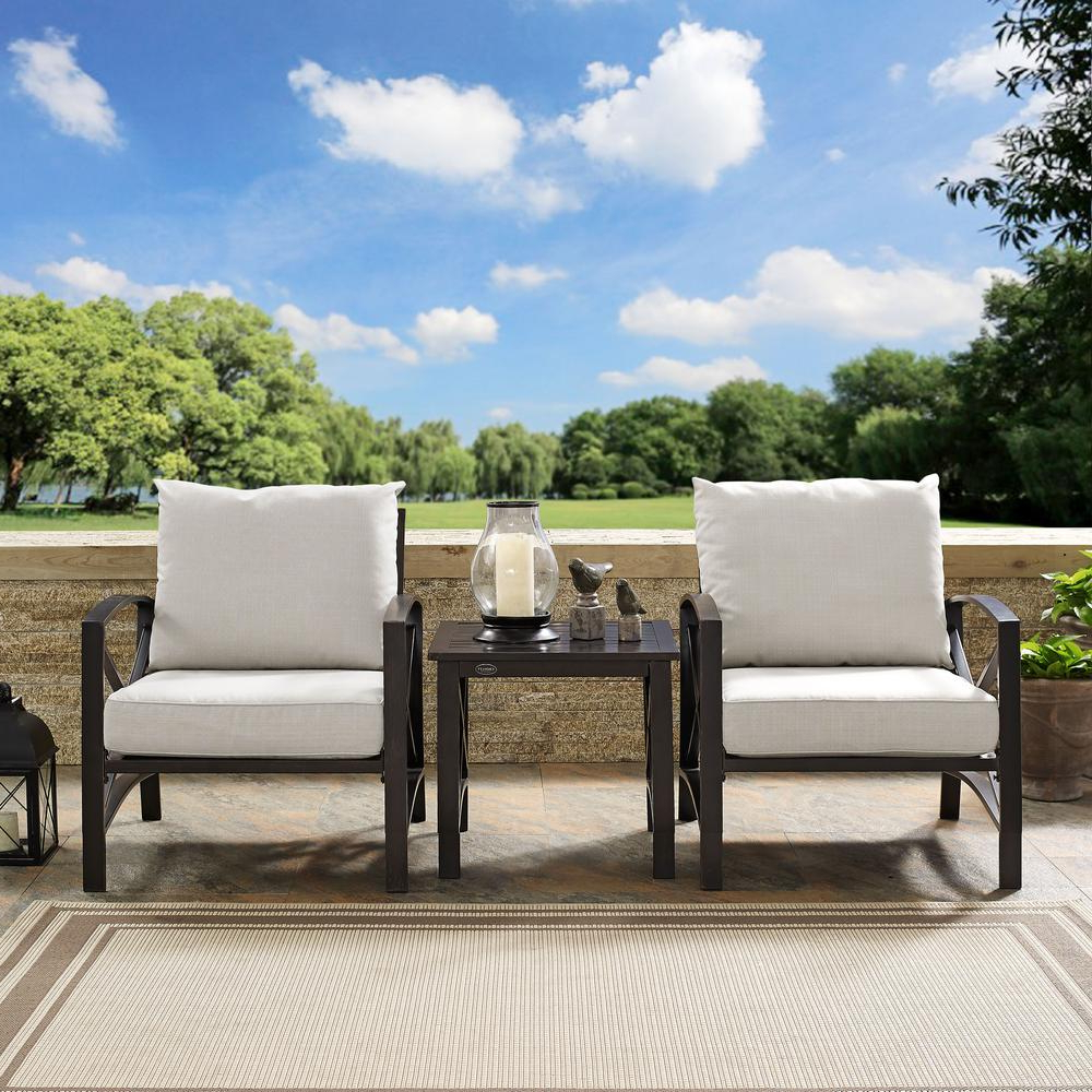 Preferred Chaise Lounge Chairs In Bronze With Oatmeal Cushions Inside Crosley Kaplan 3 Piece Metal Outdoor Seating Set With Oatmeal Cushions – 2  Chairs, Side Table (Gallery 13 of 25)