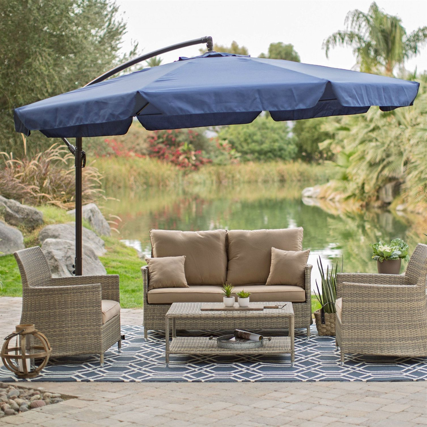 Trendy Havenside Home Newtok Mesh Reclining Patio Loungers Inside 11 Ft Offset Patio Umbrella In Blue With Base And Detachable (View 13 of 25)