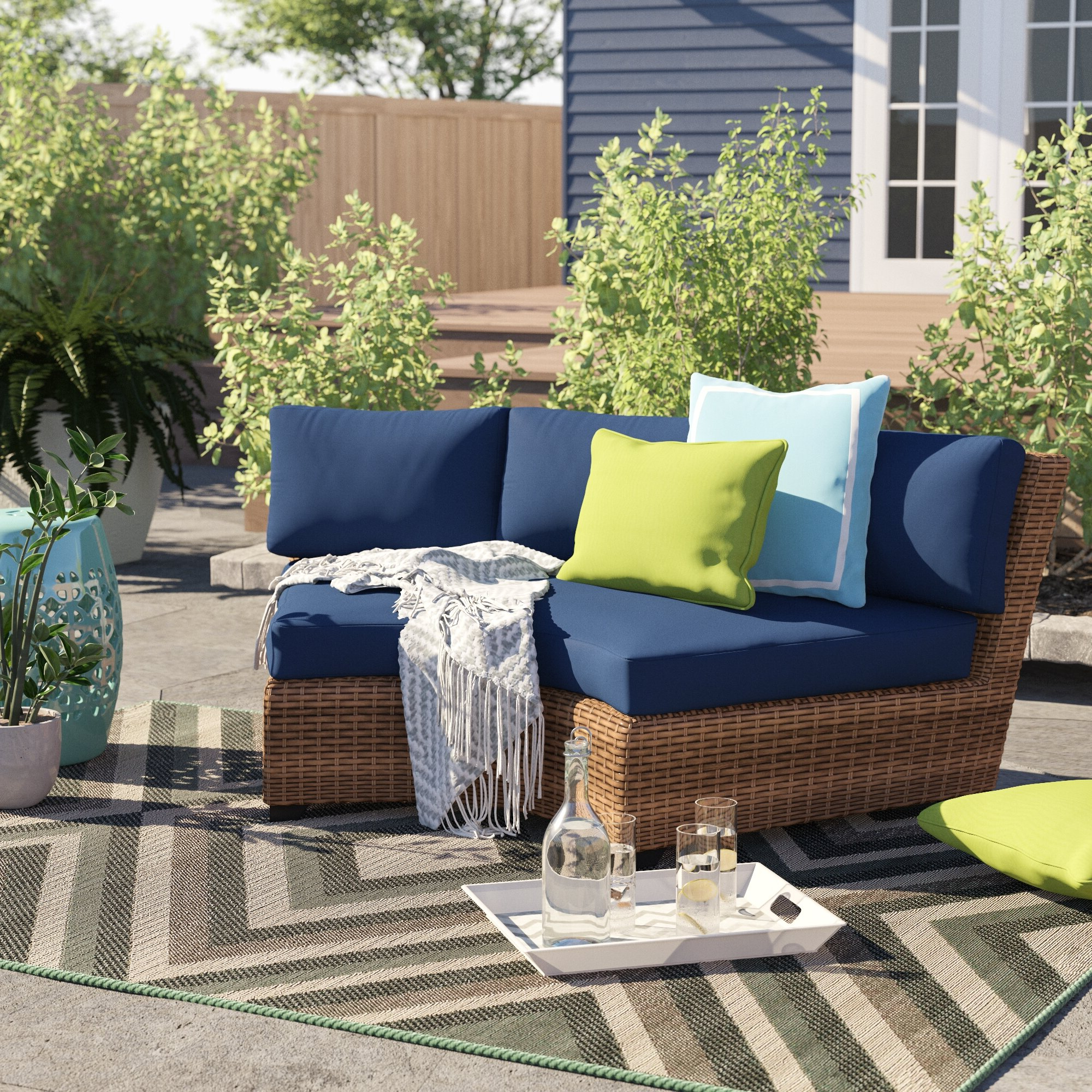 2020 Boyce Outdoor Patio Sectionals With Cushions Regarding Waterbury Curved Armless Patio Sofa With Cushions (View 23 of 25)