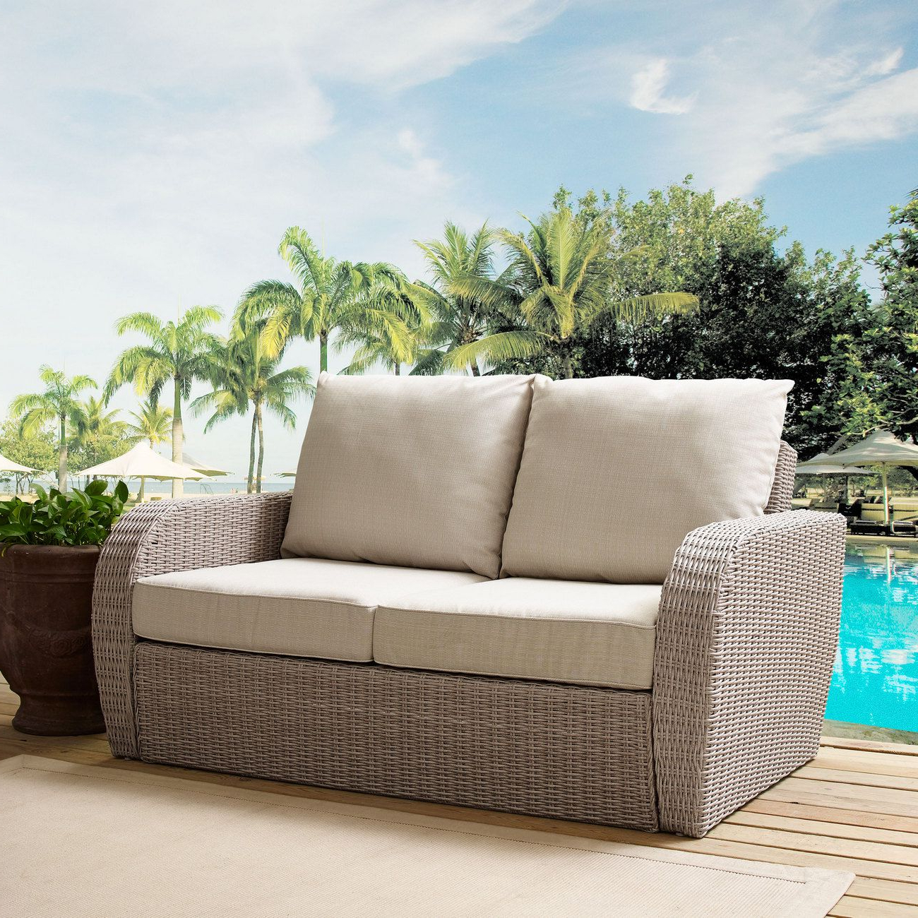 Dayse Loveseats With Cushion Within Most Current St Augustine Outdoor Wicker Loveseat In Weathered White W (View 7 of 25)
