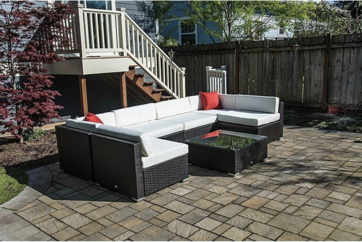 Orren Ellis Mazie 7 Piece Rattan Sectional Seating Group With Cushions Inside Widely Used Tegan Patio Sofas With Cushions (View 25 of 25)