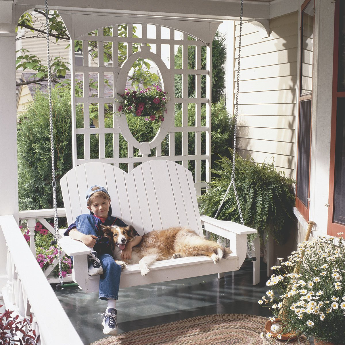 Current 10 Pretty Porch Swings – The Family Handyman Throughout Contoured Classic Porch Swings (View 11 of 25)