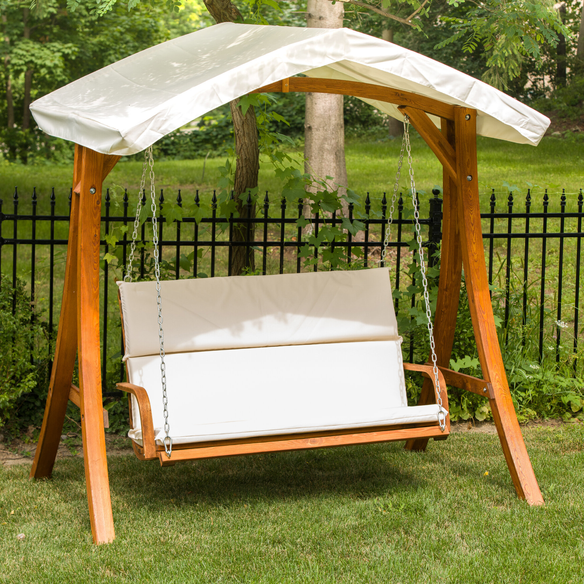 Porch Swing With Canopy Regarding Well Liked 3 Person Light Teak Oil Wood Outdoor Swings (View 9 of 25)