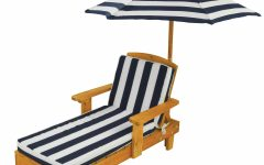 Striped Outdoor Chaises With Umbrella